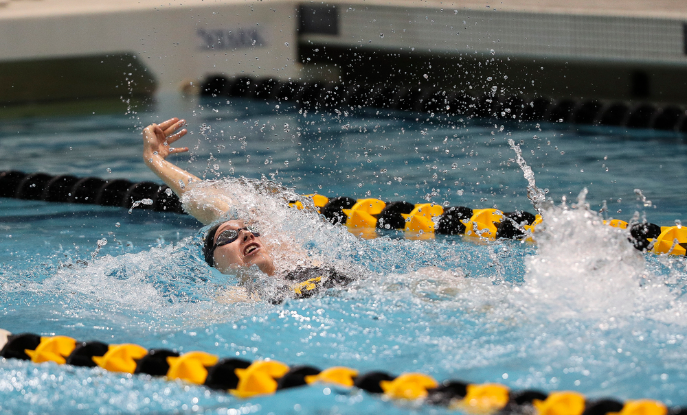 Iowa's Samantha Sauer competes in the 100-yard backstroke during the third day of the Hawkeye Invitational at the Campus Recreation and Wellness Center on November 16, 2018. (Tork Mason/hawkeyesports.com)