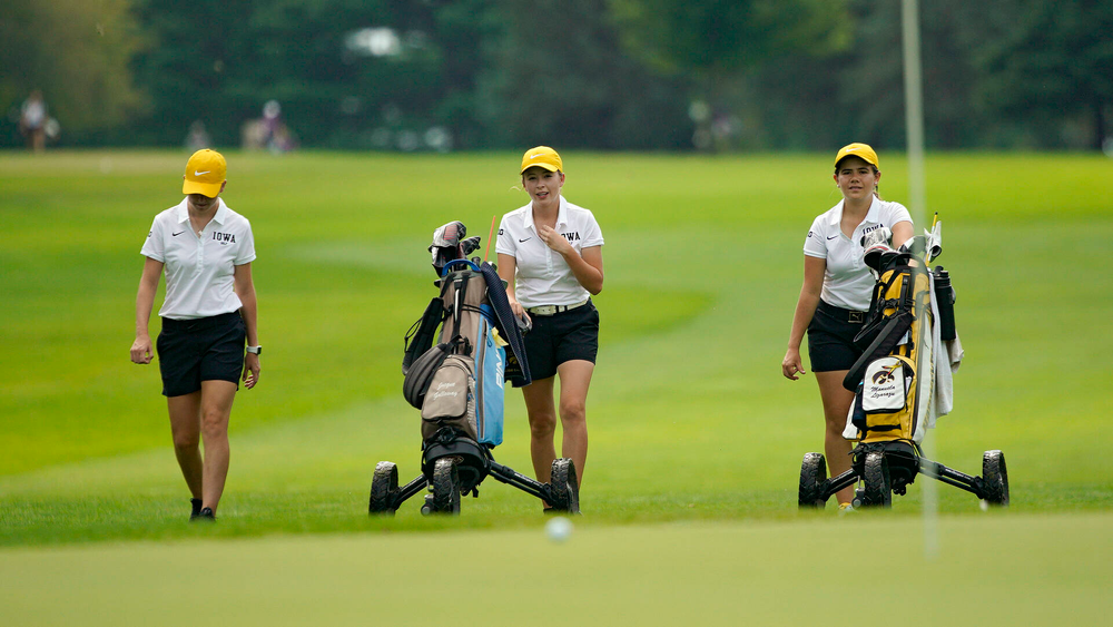 Iowa's Lea Zeitler (from left), Jacquelyn Galloway, and Manuela Lizarazu walk together during their dual against Northern Iowa at Pheasant Ridge Golf Course in Cedar Falls on Monday, Sep 2, 2019. (Stephen Mally/hawkeyesports.com)