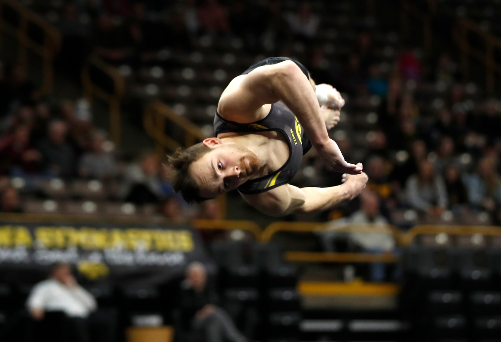 Dylan Ellsworth competes on the floor against Minnesota and Air Force