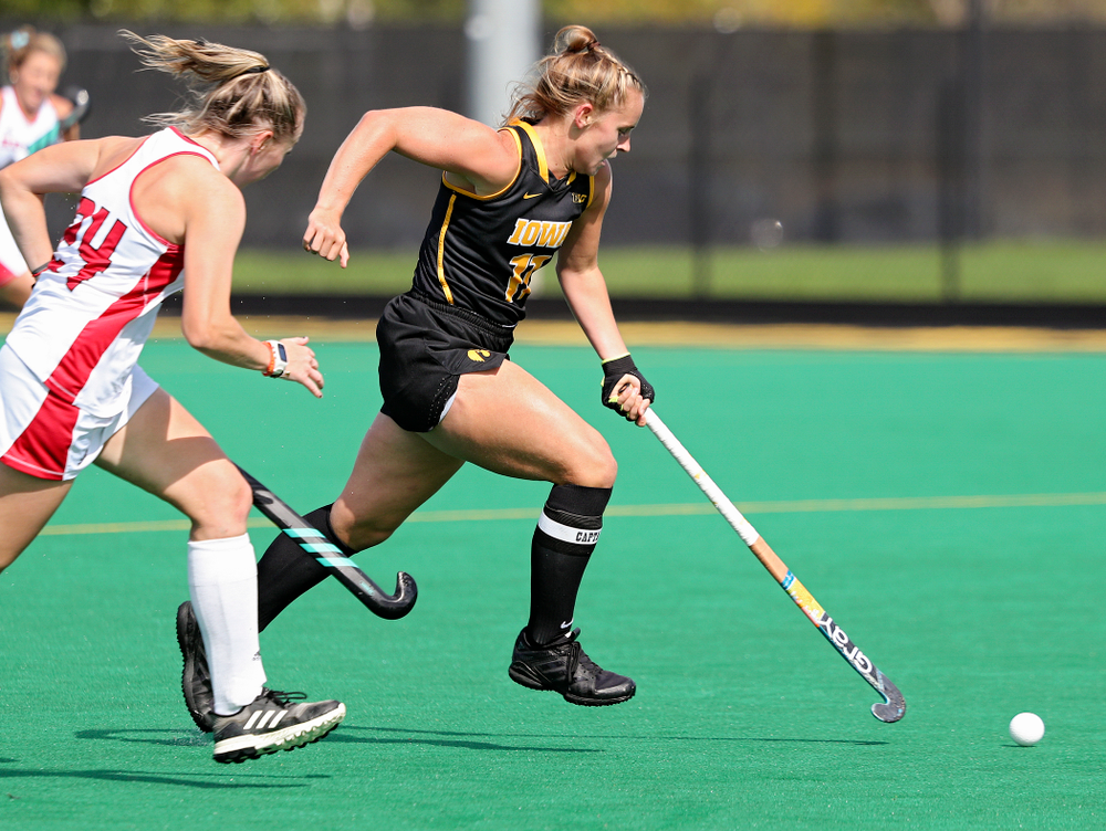 Iowa's Katie Birch (11) sprints with the ball during the first quarter of their match at Grant Field in Iowa City on Friday, Oct 4, 2019. (Stephen Mally/hawkeyesports.com)