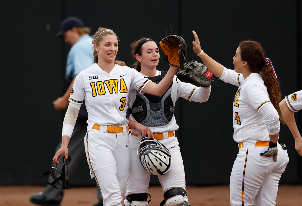 Iowa Hawkeyes starting pitcher/relief pitcher Allison Doocy (3) and infielder Taylor Libby (4) against the Minnesota Golden Gophers  Thursday, April 12, 2018 at Bob Pearl Field. (Brian Ray/hawkeyesports.com)