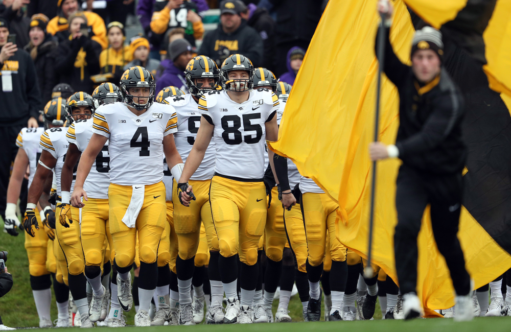 The Iowa Hawkeyes swarm the field against the Northwestern Wildcats Saturday, October 26, 2019 at Ryan Field in Evanston, Ill. (Brian Ray/hawkeyesports.com)