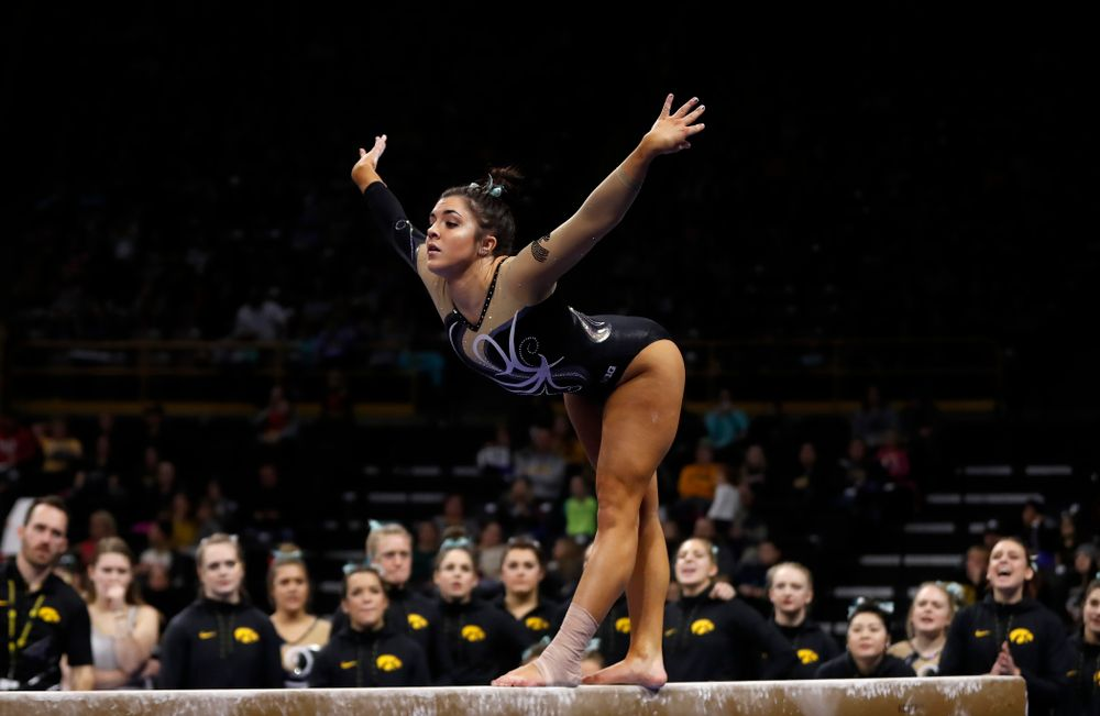 Iowa's Nikki Youd competes on the beam against the Nebraska Cornhuskers