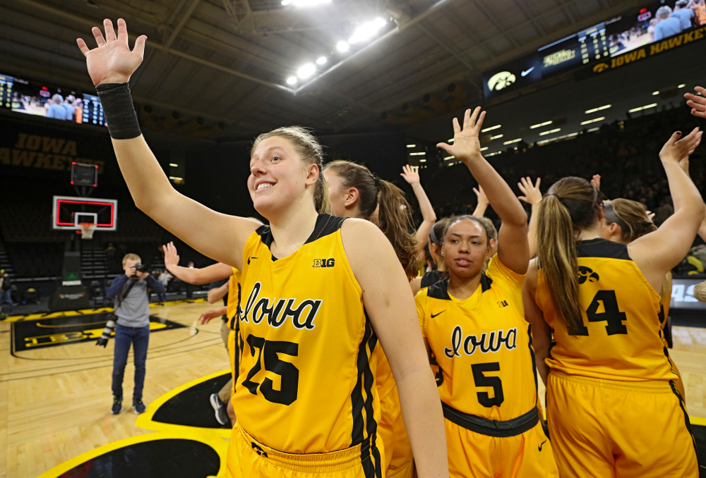 Iowa forward/center Monika Czinano (25) and guard Alexis Sevillian (5) wave to the crowd with their teammates after winning their game against Winona State at Carver-Hawkeye Arena in Iowa City on Sunday, Nov 3, 2019. (Stephen Mally/hawkeyesports.com)