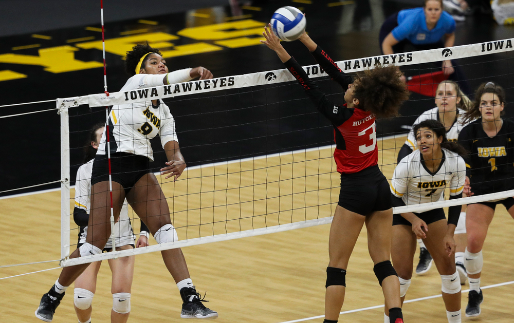 Iowa Hawkeyes middle blocker Amiya Jones (9) spikes the ball during a match against Rutgers at Carver-Hawkeye Arena on November 2, 2018. (Tork Mason/hawkeyesports.com)