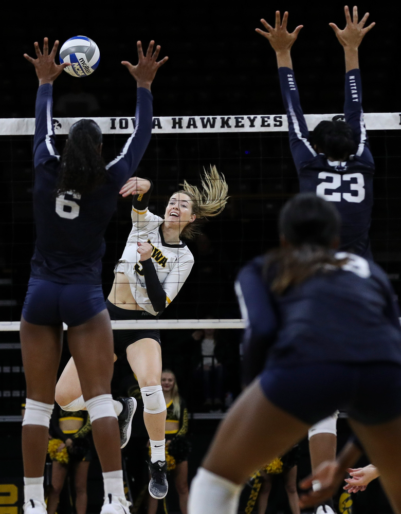 Iowa Hawkeyes outside hitter Meghan Buzzerio (5) spikes the ball during a match against Penn State at Carver-Hawkeye Arena on November 3, 2018. (Tork Mason/hawkeyesports.com)