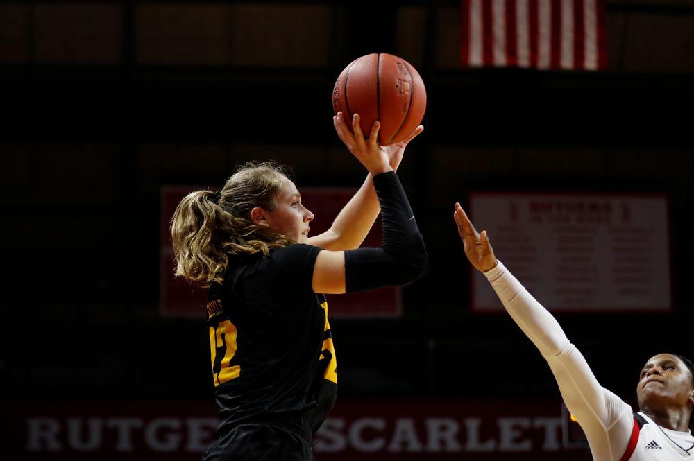 Iowa Hawkeyes guard Kathleen Doyle (22) hits the game tying three point basket