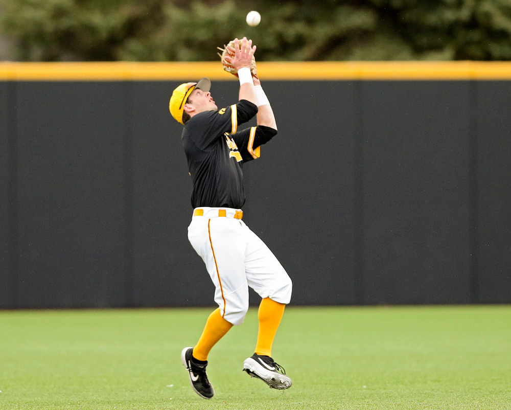 Iowa Hawkeyes second baseman Mitchell Boe (4) pulls in a pop up for an out during the fifth inning of their game against Illinois State at Duane Banks Field in Iowa City on Wednesday, Apr. 3, 2019. (Stephen Mally/hawkeyesports.com)