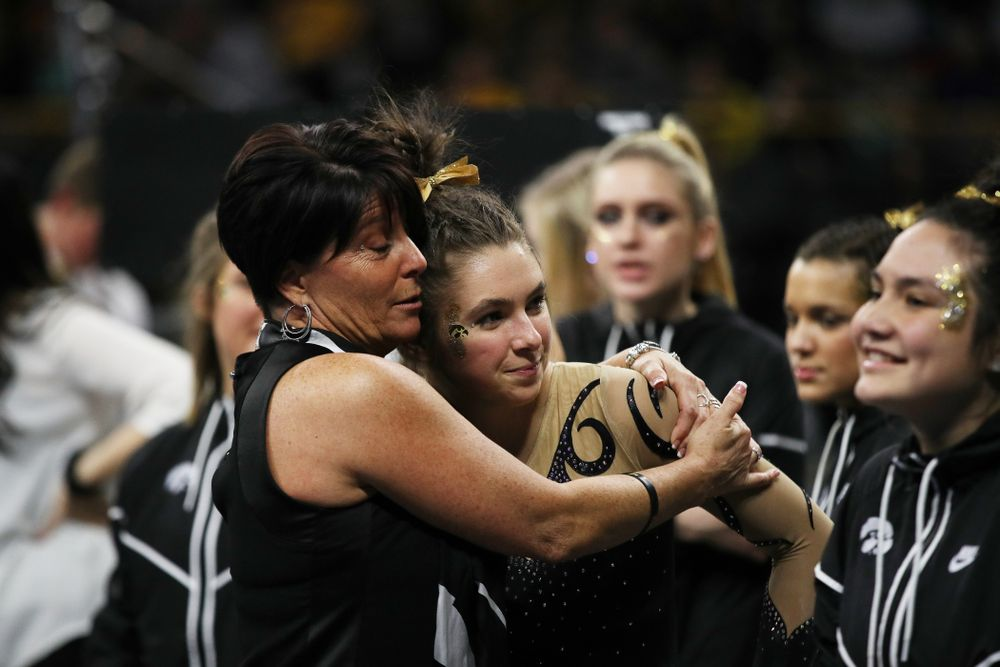 Iowa assistant coach Jennifer Green hugs Bridget Killian after her performance on the beam during their meet against Southeast Missouri State Friday, January 11, 2019 at Carver-Hawkeye Arena. (Brian Ray/hawkeyesports.com)
