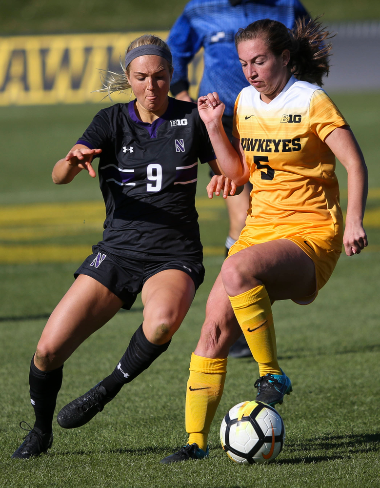 Iowa Hawkeyes defender Riley Whitaker (5) dribbles the ball during a game against Northwestern at the Iowa Soccer Complex on October 21, 2018. (Tork Mason/hawkeyesports.com)