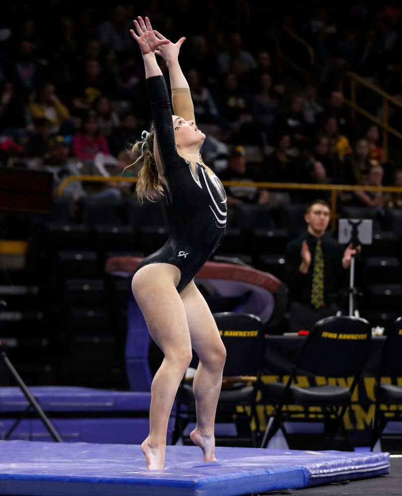 Iowa's Charlotte Sullivan competes on the floor against the Nebraska Cornhuskers