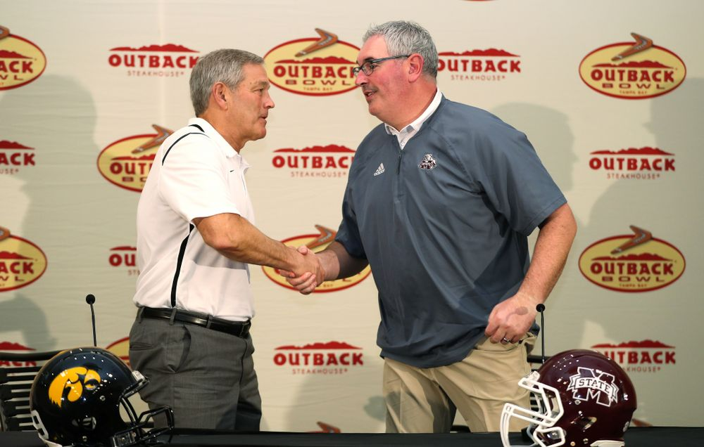 Iowa Hawkeyes head coach Kirk Ferentz and Mississippi State head coach Joe Moorhead shake hands during the Outback Bowl coach's press conference Saturday, December 29, 2018 in Tampa, FL. (Brian Ray/hawkeyesports.com)