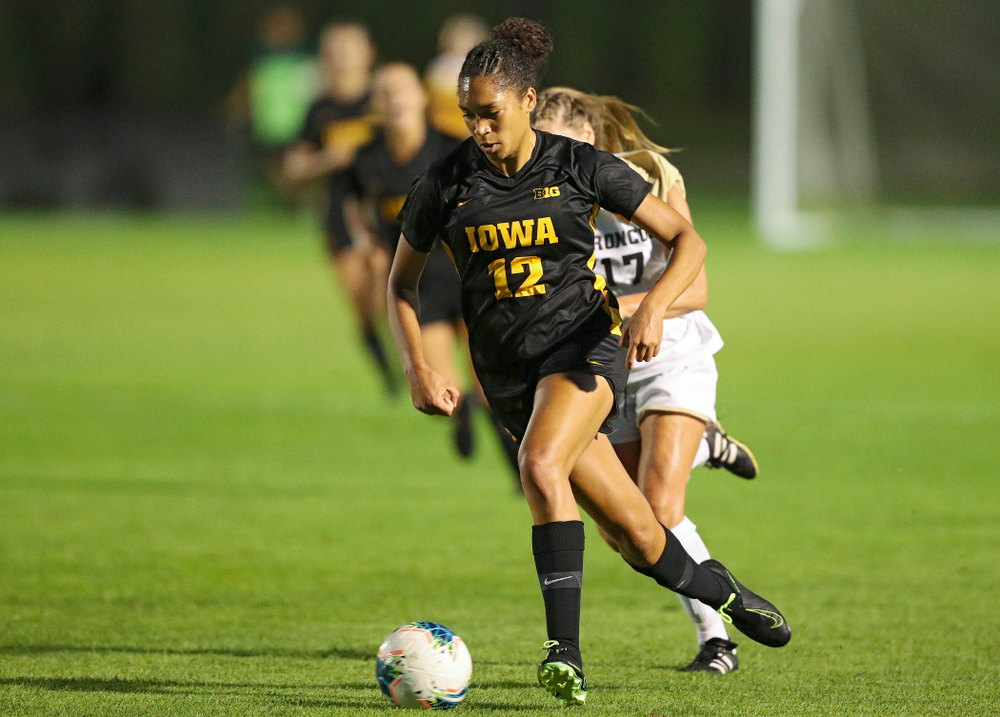 Iowa forward Olivia Fiegel (12) moves with the ball during the second half of their match against Western Michigan at the Iowa Soccer Complex in Iowa City on Thursday, Aug 22, 2019. (Stephen Mally/hawkeyesports.com)