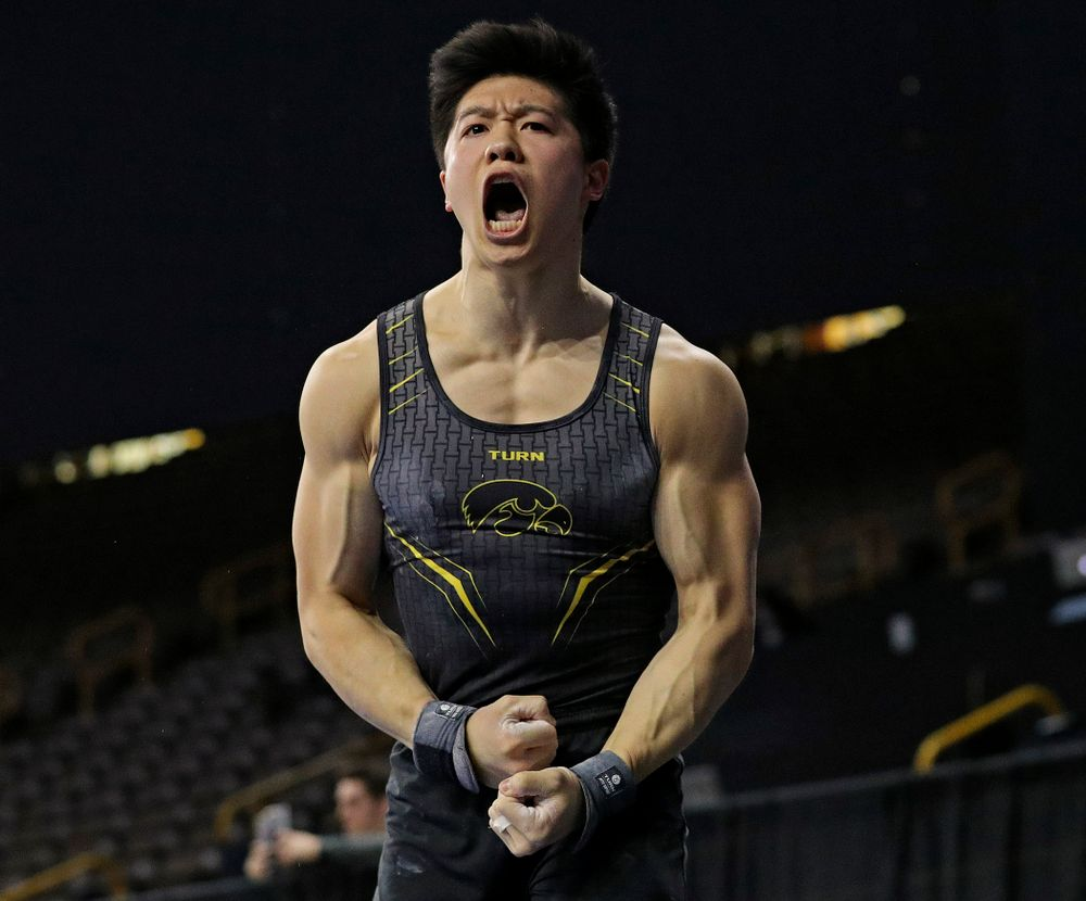 Iowa's Bennet Huang celebrates after competing in the pommel during the first day of the Big Ten Men's Gymnastics Championships at Carver-Hawkeye Arena in Iowa City on Friday, Apr. 5, 2019. (Stephen Mally/hawkeyesports.com)