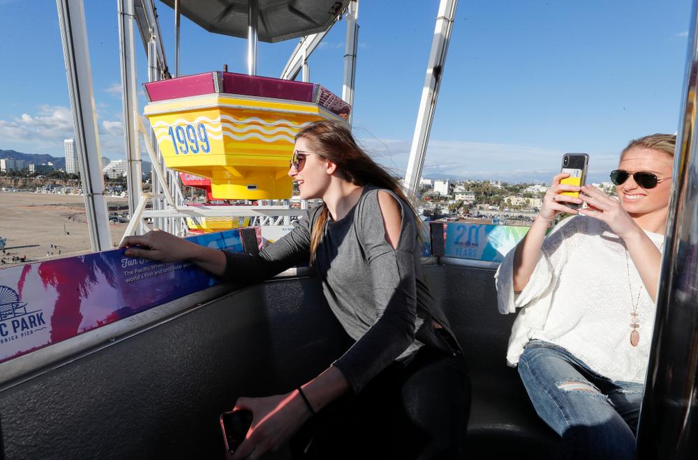 Iowa Hawkeyes forward Megan Gustafson (10) and guard Makenzie Meyer (3) ride the ferris wheel in Pacific Park on the Santa Monica Pier Thursday, March 15, 2018 in Santa Monica. (Brian Ray/hawkeyesports.com)