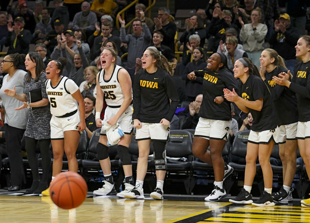 The Iowa bench reacts after forward Amanda Ollinger (not pictured) maked a basket while being fouled during the third quarter of their game at Carver-Hawkeye Arena in Iowa City on Sunday, January 12, 2020. (Stephen Mally/hawkeyesports.com)
