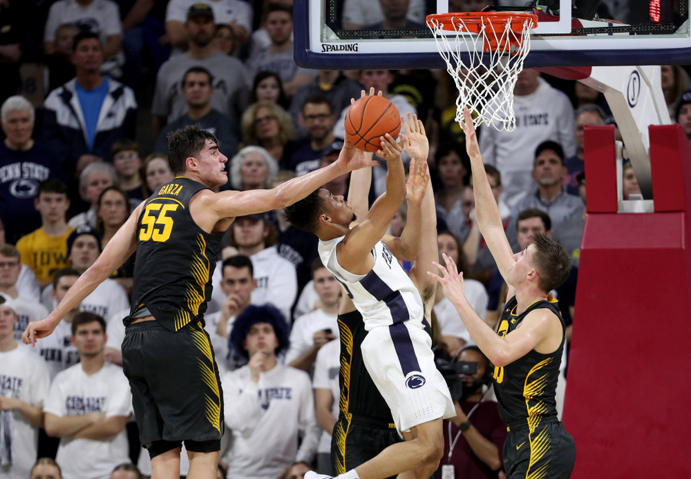 Iowa Hawkeyes forward Luka Garza (55) blocks a shot against Penn State Friday, January 3, 2020 at the Palestra in Philadelphia. (Brian Ray/hawkeyesports.com)