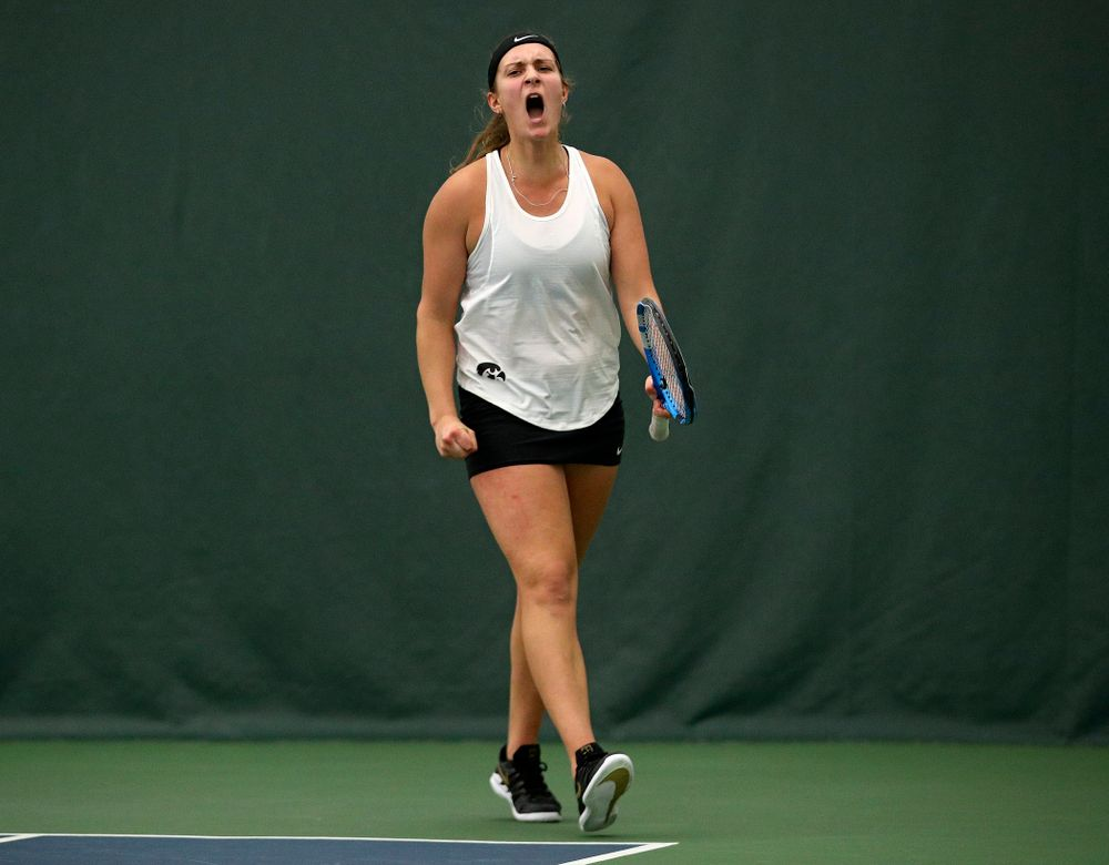Iowa's Ashleigh Jacobs celebrates a point during her singles match at the Hawkeye Tennis and Recreation Complex in Iowa City on Sunday, February 23, 2020. (Stephen Mally/hawkeyesports.com)