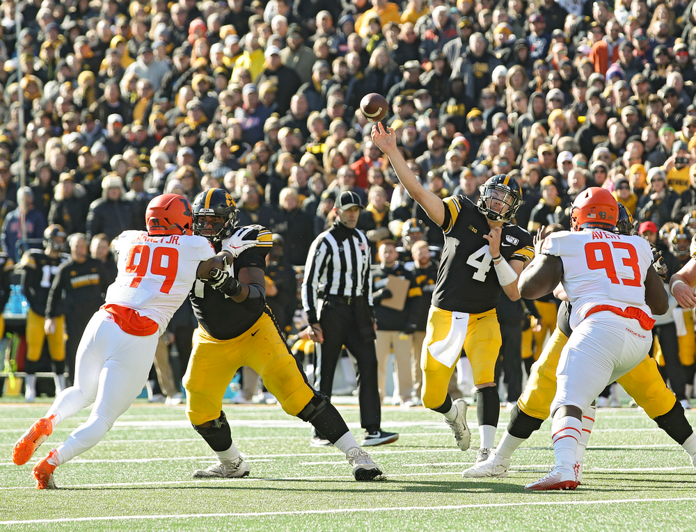 Iowa Hawkeyes quarterback Nate Stanley (4) throws a pass during the second quarter of their game at Kinnick Stadium in Iowa City on Saturday, Nov 23, 2019. (Stephen Mally/hawkeyesports.com)