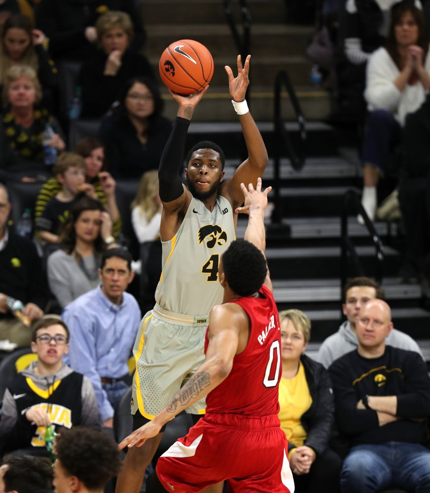 Iowa Hawkeyes guard Isaiah Moss (4) knocks down a three point basket against the Nebraska Cornhuskers Sunday, January 6, 2019 at Carver-Hawkeye Arena. (Brian Ray/hawkeyesports.com)