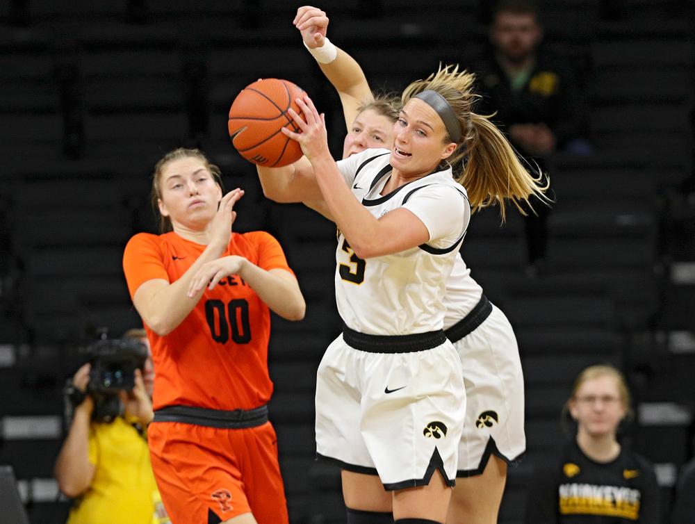 Iowa guard Makenzie Meyer (3) pulls down a rebound during the fourth quarter of their overtime win against Princeton at Carver-Hawkeye Arena in Iowa City on Wednesday, Nov 20, 2019. (Stephen Mally/hawkeyesports.com)