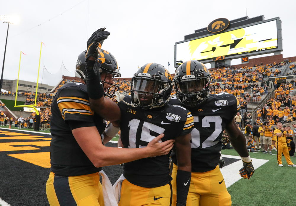 Iowa Hawkeyes quarterback Spencer Petras (7), running back Tyler Goodson (15), and linebacker Amani Jones (52) against Middle Tennessee State Saturday, September 28, 2019 at Kinnick Stadium. (Brian Ray/hawkeyesports.com)