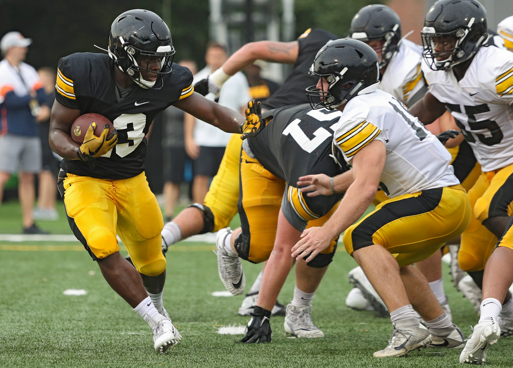 Iowa Hawkeyes running back Shadrick Byrd (23) eyes linebacker Mike Timm (19) durning Fall Camp Practice No. 17 at the Hansen Football Performance Center in Iowa City on Wednesday, Aug 21, 2019. (Stephen Mally/hawkeyesports.com)
