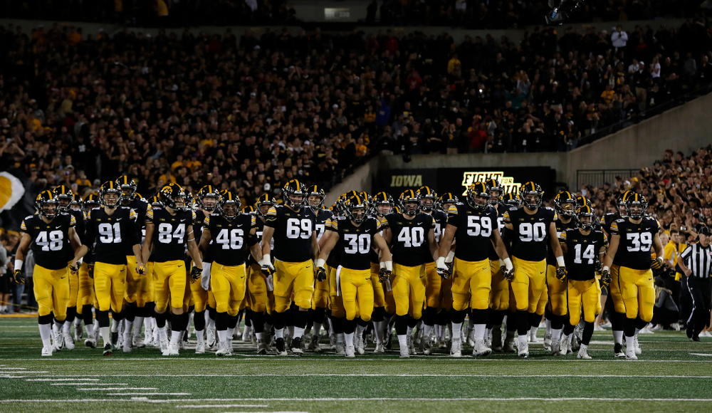 The Iowa Hawkeyes swarm onto the field before their game against the Wisconsin Badgers Saturday, September 22, 2018 at Kinnick Stadium. (Brian Ray/hawkeyesports.com)