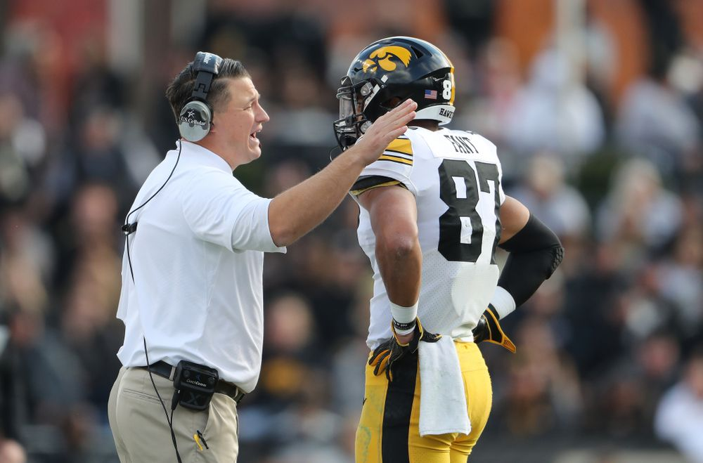 Iowa Hawkeyes offensive coordinator Brian Ferentz talks with tight end Noah Fant (87) during their game against the Purdue Boilermakers Saturday, November 3, 2018 Ross Ade Stadium in West Lafayette, Ind. (Brian Ray/hawkeyesports.com)
