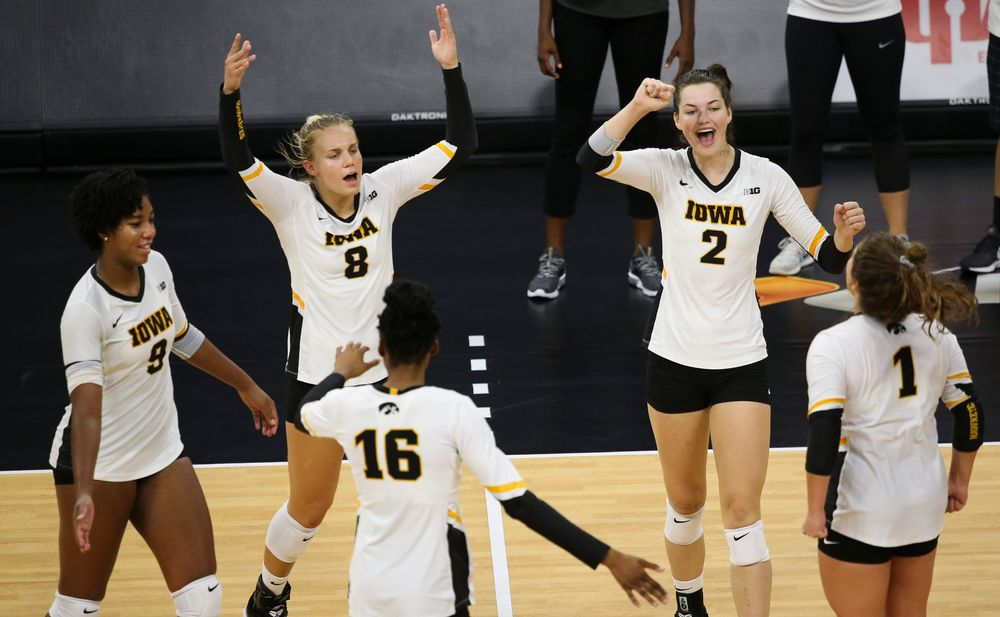 Iowa Hawkeyes middle blocker Amiya Jones (9), Iowa Hawkeyes right side hitter Reghan Coyle (8), Iowa Hawkeyes setter Courtney Buzzerio (2)