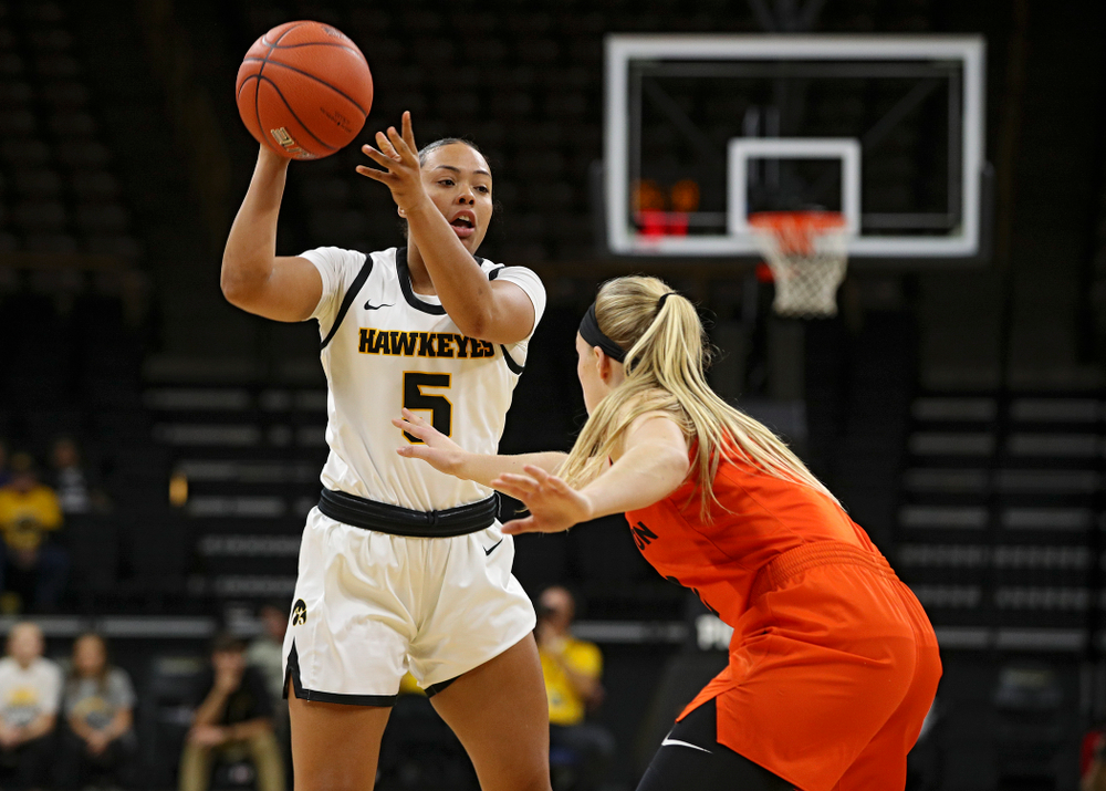 Iowa guard Alexis Sevillian (5) passes the ball during the first quarter of their overtime win against Princeton at Carver-Hawkeye Arena in Iowa City on Wednesday, Nov 20, 2019. (Stephen Mally/hawkeyesports.com)