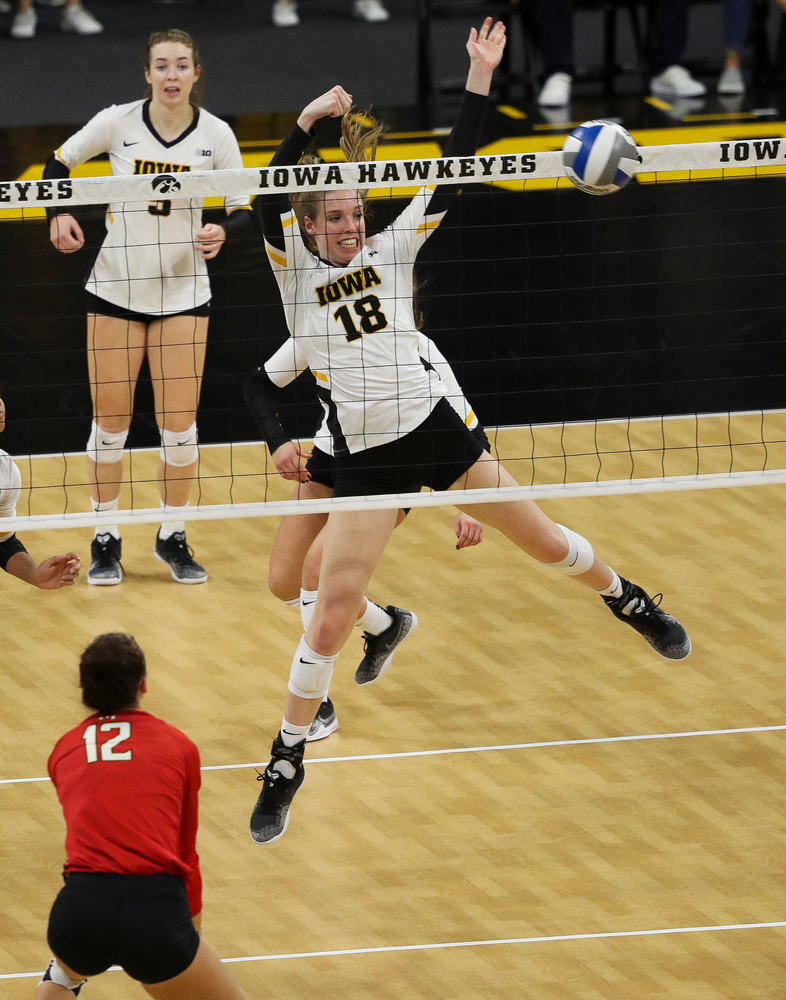 Iowa Hawkeyes middle blocker Hannah Clayton (18) goes up for a block during a match against Maryland at Carver-Hawkeye Arena on November 23, 2018. (Tork Mason/hawkeyesports.com)