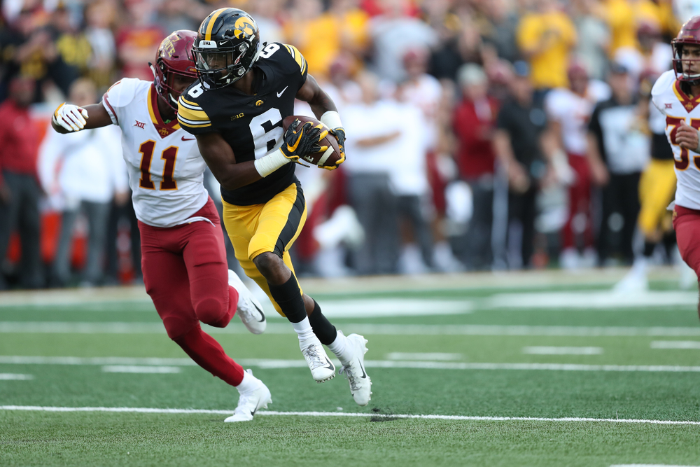 Iowa Hawkeyes wide receiver Ihmir Smith-Marsette (6) picks up a first down against the Iowa State Cyclones Saturday, September 8, 2018 at Kinnick Stadium. (Max Allen/hawkeyesports.com)