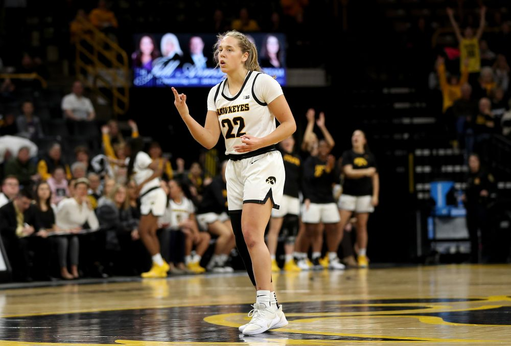 Iowa Hawkeyes guard Kathleen Doyle (22) knocks down a three point basket against North Carolina Central Saturday, December 14, 2019 at Carver-Hawkeye Arena. (Brian Ray/hawkeyesports.com)