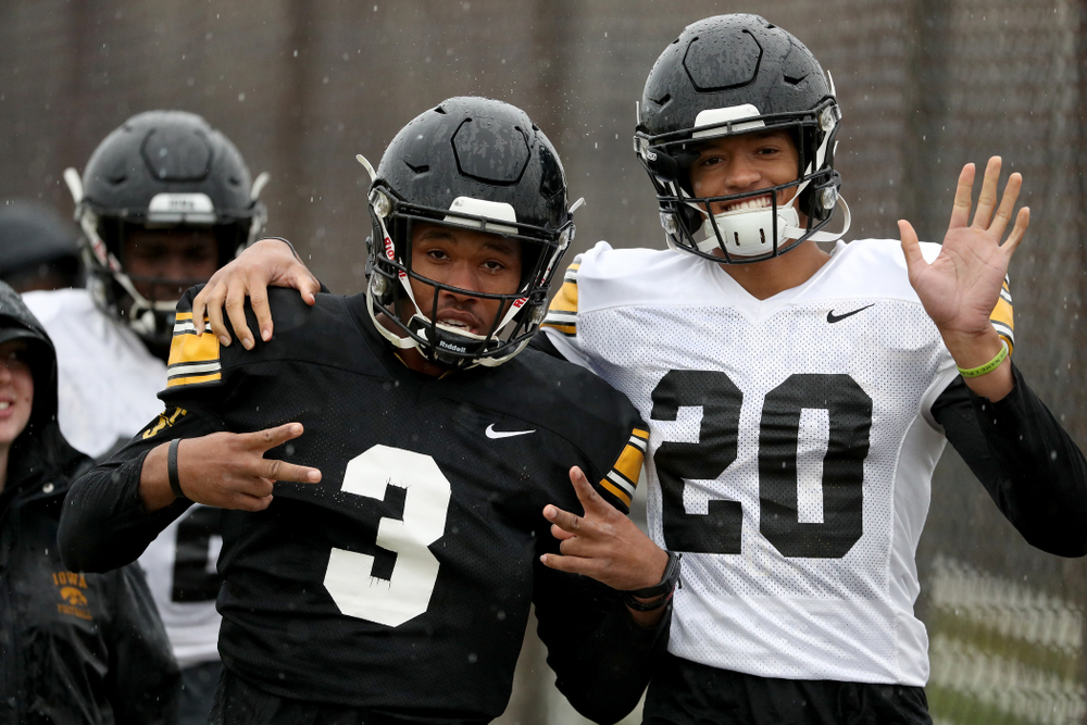 Iowa Hawkeyes wide receiver Tyrone Tracy Jr. (3) and defensive back Julius Brents (20) during practice Monday, December 23, 2019 at Mesa College in San Diego. (Brian Ray/hawkeyesports.com)