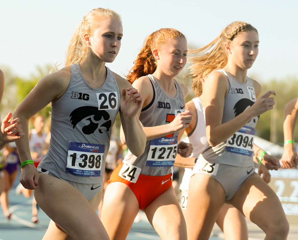 Iowa's Kylie Latham (left) and Jessica McKee (right) run the women's 10,000 meter event during the first day of the Drake Relays at Drake Stadium in Des Moines on Thursday, Apr. 25, 2019. (Stephen Mally/hawkeyesports.com)
