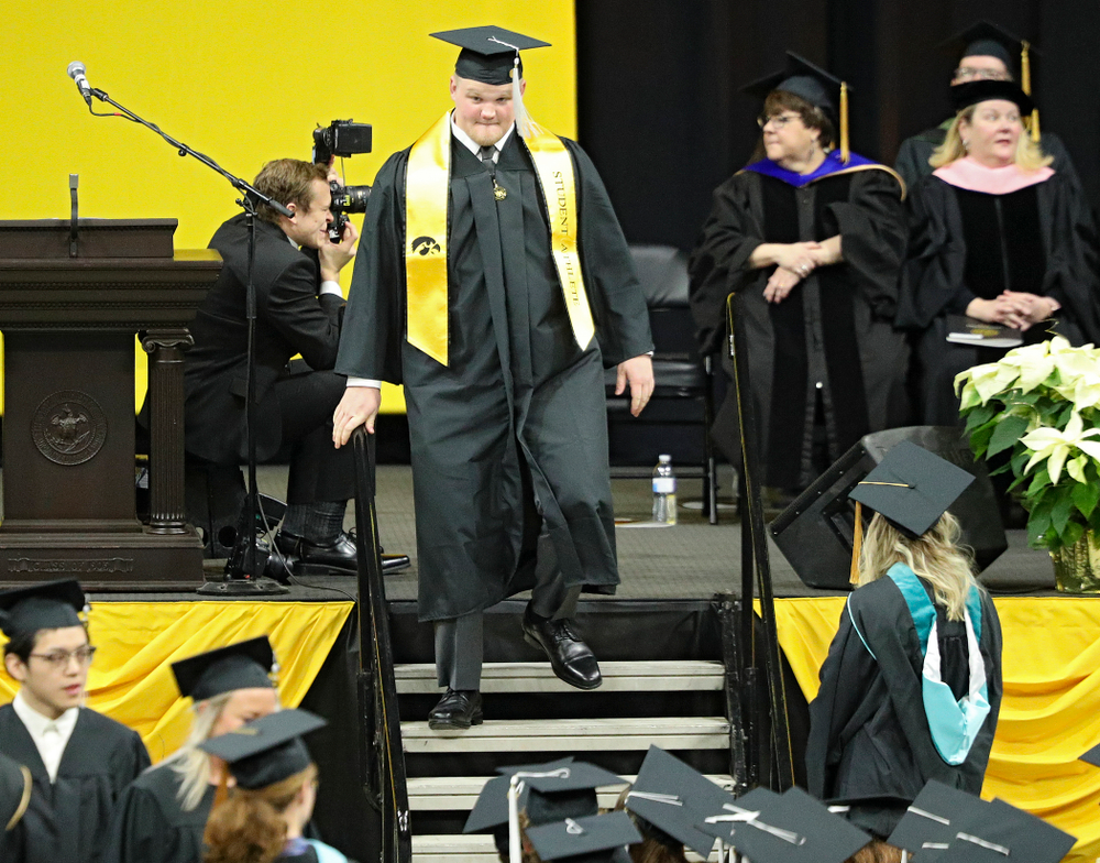 Iowa offensive lineman Spencer Williams during the College of Liberal Arts and Sciences and University College Fall 2019 Commencement ceremony at Carver-Hawkeye Arena in Iowa City on Saturday, December 21, 2019. (Stephen Mally/hawkeyesports.com)