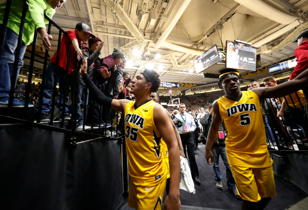 Iowa Hawkeyes forward Cordell Pemsl (35) and forward Tyler Cook (5)