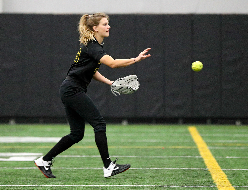 Iowa infielder Mia Ruther (26) tosses the ball to first base during practice at Iowa Softball Media Day at the Hawkeye Tennis and Recreation Complex in Iowa City on Thursday, January 30, 2020. (Stephen Mally/hawkeyesports.com)