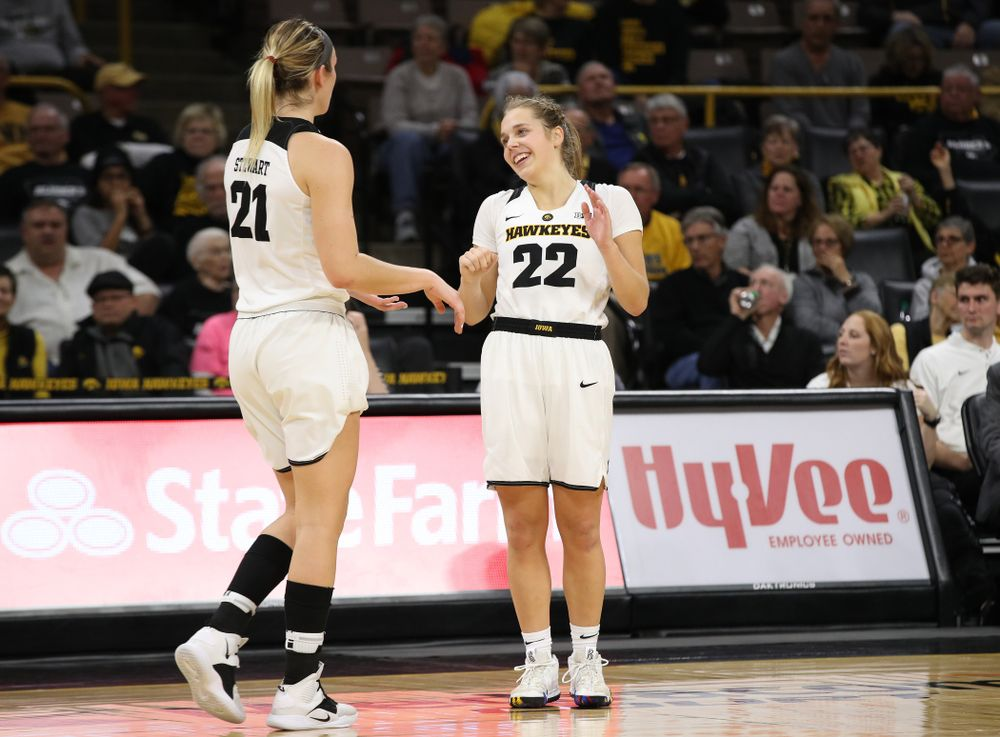 Iowa Hawkeyes forward Hannah Stewart (21) and guard Kathleen Doyle (22) against the Wisconsin Badgers Monday, January 7, 2019 at Carver-Hawkeye Arena.  (Brian Ray/hawkeyesports.com)