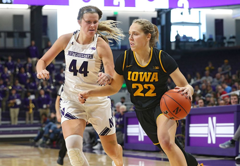 Iowa Hawkeyes guard Kathleen Doyle (22) drives with the ball during the first quarter of their game at Welsh-Ryan Arena in Evanston, Ill. on Sunday, January 5, 2020. (Stephen Mally/hawkeyesports.com)