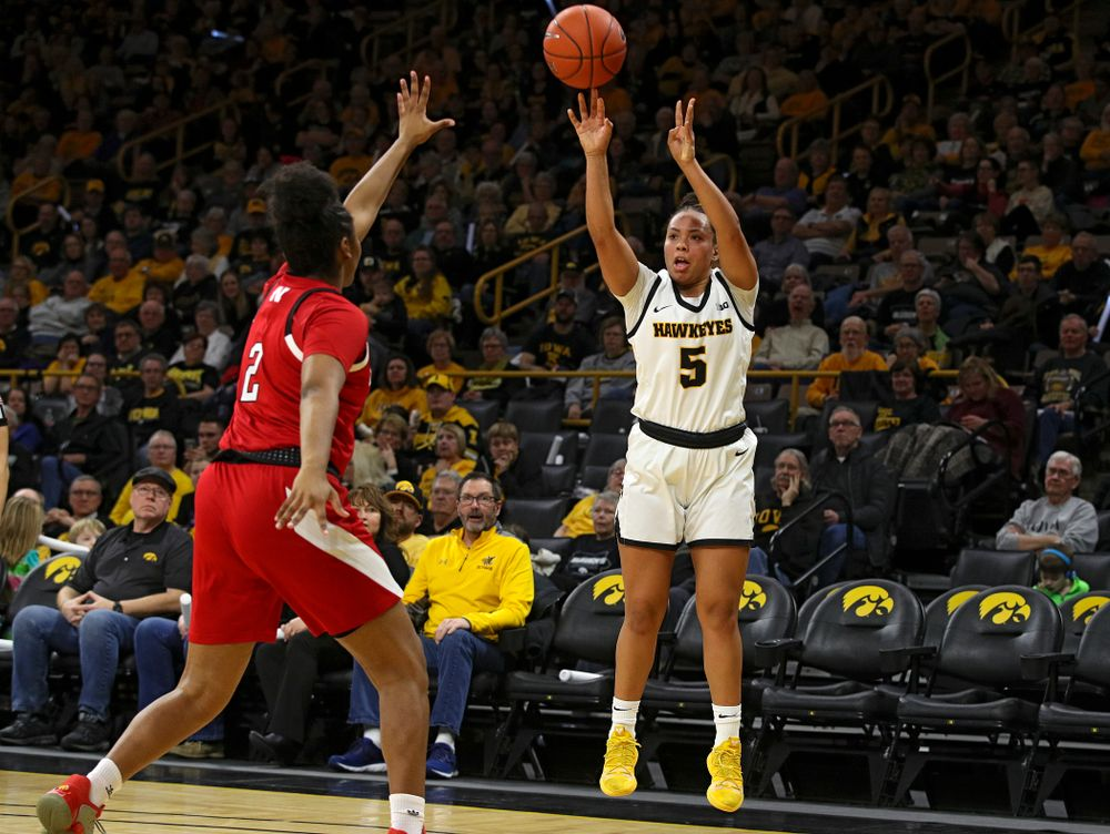 Iowa Hawkeyes guard Alexis Sevillian (5) makes a 3-pointer during the second quarter of the game at Carver-Hawkeye Arena in Iowa City on Thursday, February 6, 2020. (Stephen Mally/hawkeyesports.com)