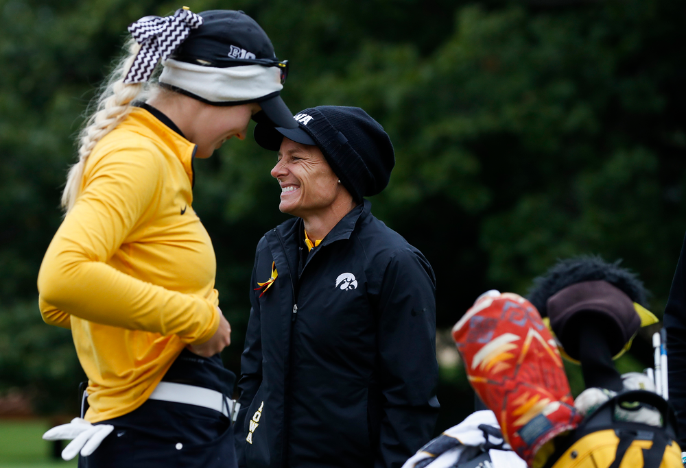 Iowa head coach Megan Menzel shares a laugh with Shawn Rennegarbe at the eighth tee during the Diane Thomason Invitational at Finkbine Golf Course on September 29, 2018. (Tork Mason/hawkeyesports.com)