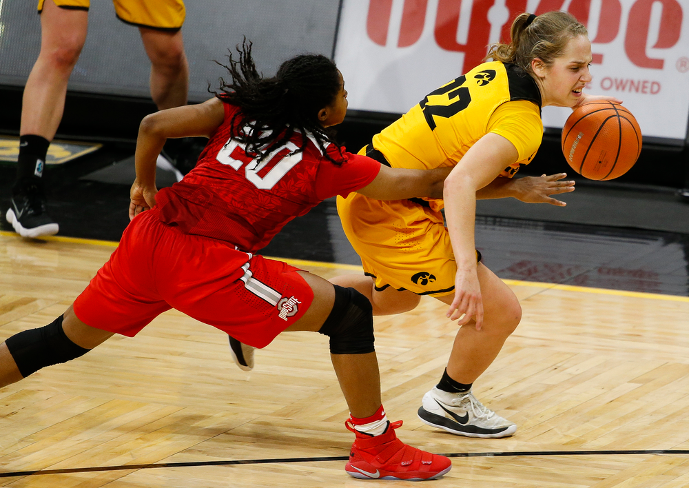 Iowa Hawkeyes guard Kathleen Doyle (22) is fouled during a game against the Ohio State Buckeyes at Carver-Hawkeye Arena on January 25, 2018. (Tork Mason/hawkeyesports.com)