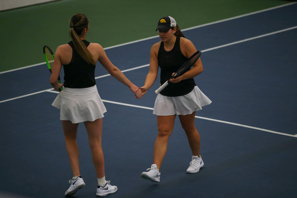 IowaÕs Danielle Bauers (left) at womenÕs tennis senior day vs Nebraska on Saturday, April 13, 2019 at the Hawkeye Tennis and Recreation Complex. (Lily Smith/hawkeyesports.com)