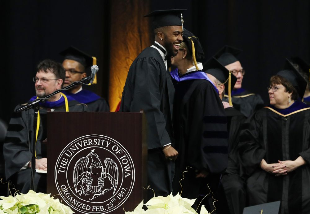 Iowa Track's Christian Brissett during the Fall Commencement Ceremony  Saturday, December 15, 2018 at Carver-Hawkeye Arena. (Brian Ray/hawkeyesports.com)