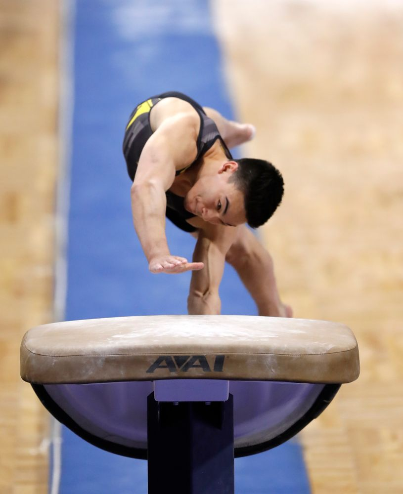 Brandon Wong competes on the vault against Illinois
