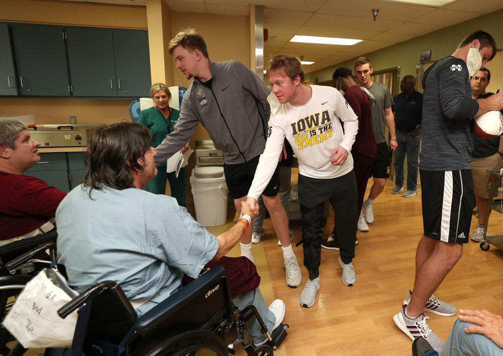 Iowa Hawkeyes quarterback Spencer Petras (7) and wide receiver Max Cooper (19) shake hands with patients during a visit to Tampa General Hospital as part of the Outback Bowl Friday, December 28, 2018 in Tampa, FL.(Brian Ray/hawkeyesports.com)