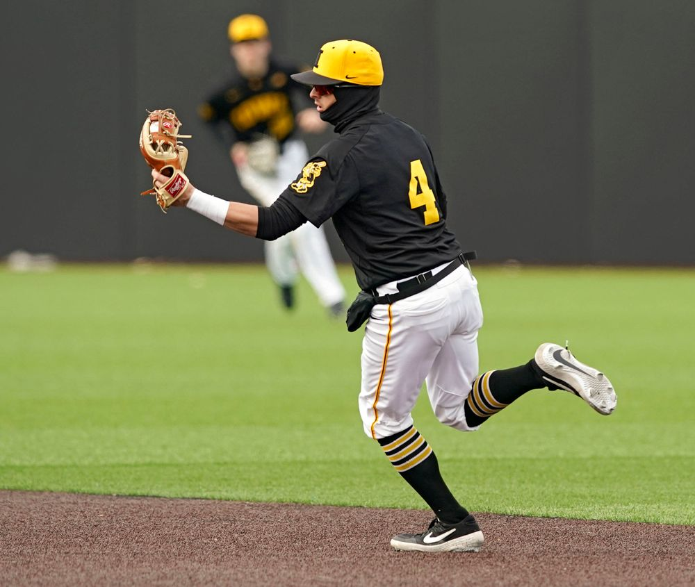 Iowa Hawkeyes second baseman Mitchell Boe (4) snags a line drive during the fourth inning of their game against Illinois at Duane Banks Field in Iowa City on Saturday, Mar. 30, 2019. (Stephen Mally/hawkeyesports.com)