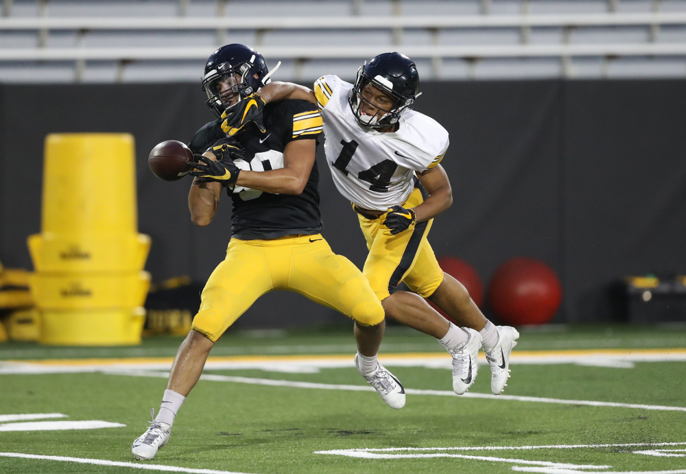 Iowa Hawkeyes defensive back Daraun McKinney (14) breaks up a pass intended for Iowa Hawkeyes wide receiver Nico Ragaini (89)